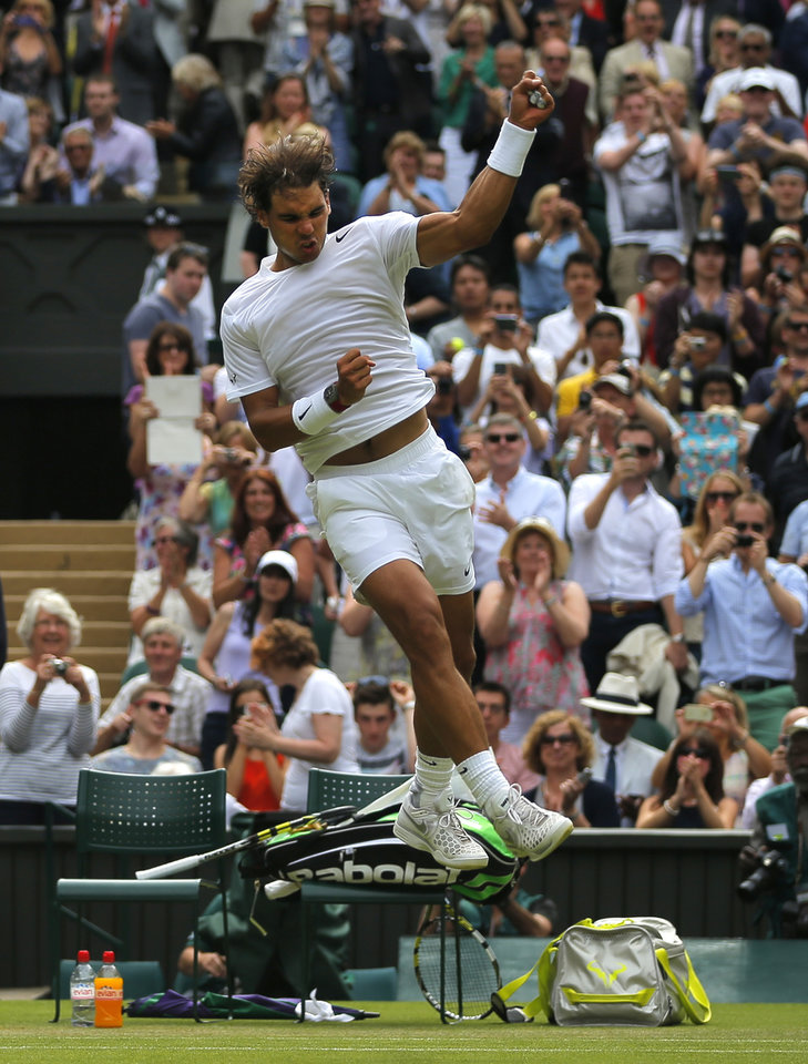 Photo - Rafael Nadal of Spain celebrates after he defeated Lukas Rosol of the Czech Republic in their men's singles match on Centre Court at the All England Lawn Tennis Championships in Wimbledon, London, Thursday, June 26, 2014. (AP Photo/Pavel Golovkin)