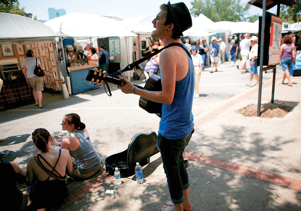 Photo - Baylor Judd, of Oklahoma City, performs Sunday during the Paseo Arts Festival.