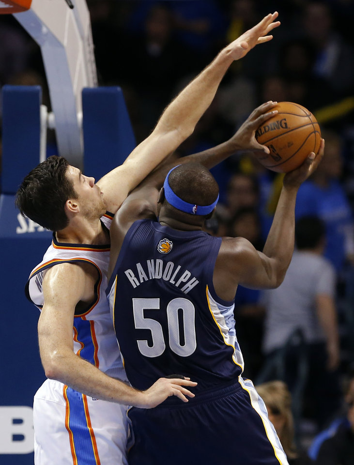 Photo - Oklahoma City's Nick Collison (4) defends against Memphis' Zach Randolph (50) during the NBA basketball game between the Oklahoma City Thunder and the Memphis Grizzlies at the Chesapeake Energy Arena in Oklahoma City,  Thursday, Jan. 31, 2013.Photo by Sarah Phipps, The Oklahoman