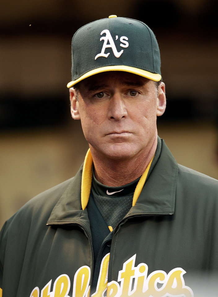 Photo -   Oakland Athletics manager Bob Melvin waits for the baseball game to begin against the Boston Red Sox Friday, Aug. 31, 2012, in Oakland, Calif. (AP Photo/Ben Margot)