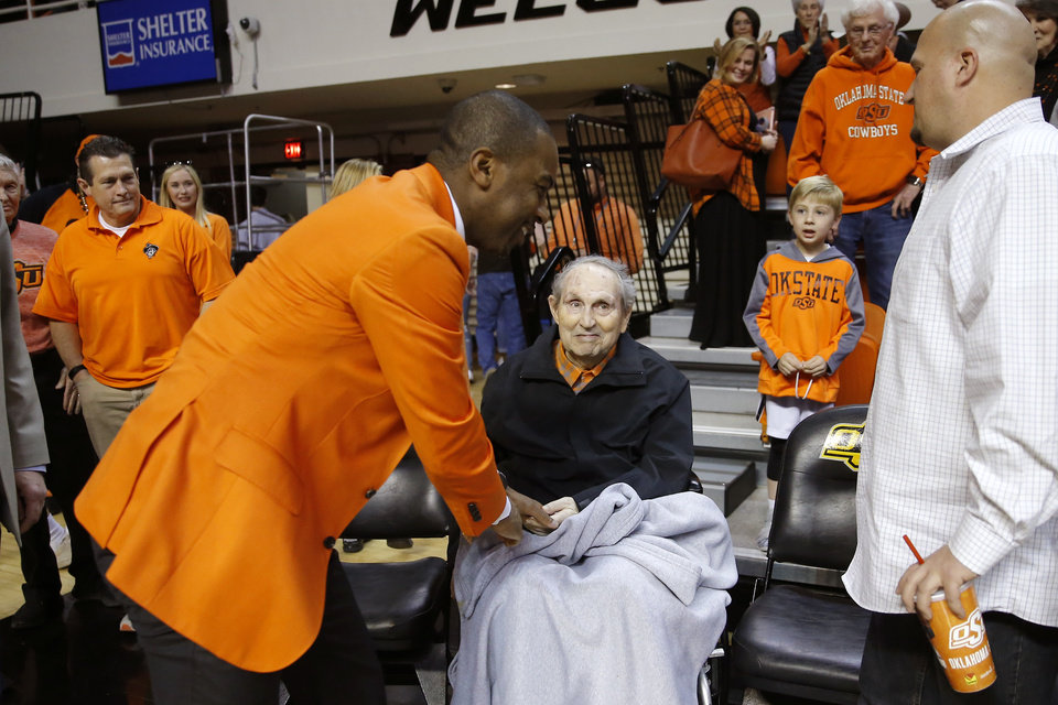 Photo - Oklahoma State coach Mike Boynton greets former coach Eddie Sutton after an NCAA men's Bedlam basketball game between the Oklahoma State University Cowboys (OSU) and the University of Oklahoma Sooners (OU) at Gallagher-Iba Arena in Stillwater, Okla., Saturday, Feb. 22, 2020. Oklahoma State won 83-66. [Bryan Terry/The Oklahoman]