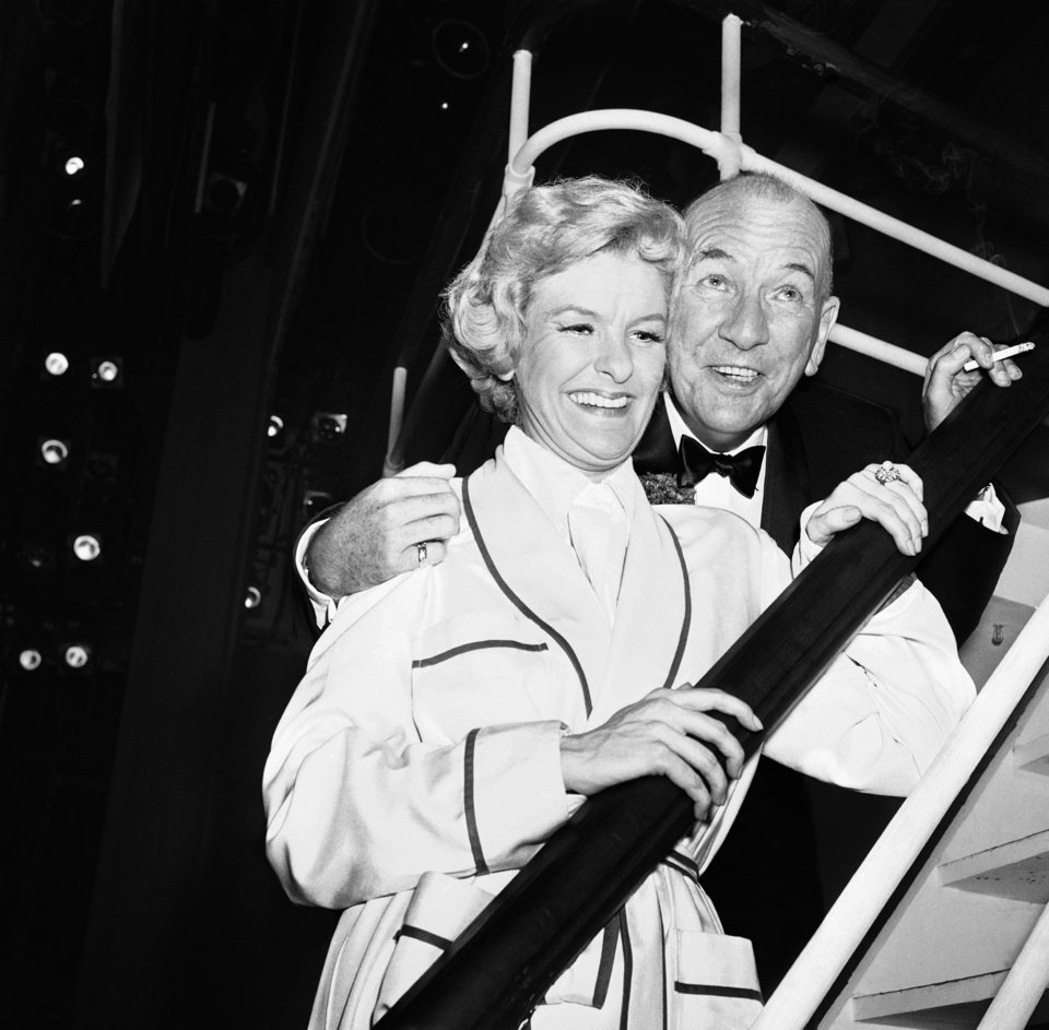 Photo - FILE - This Oct. 3, 1961 file photo shows Noel Coward, right, with actress Elaine Stritch backstage at New York's Broadhurst Theatre after the Broadway opening of