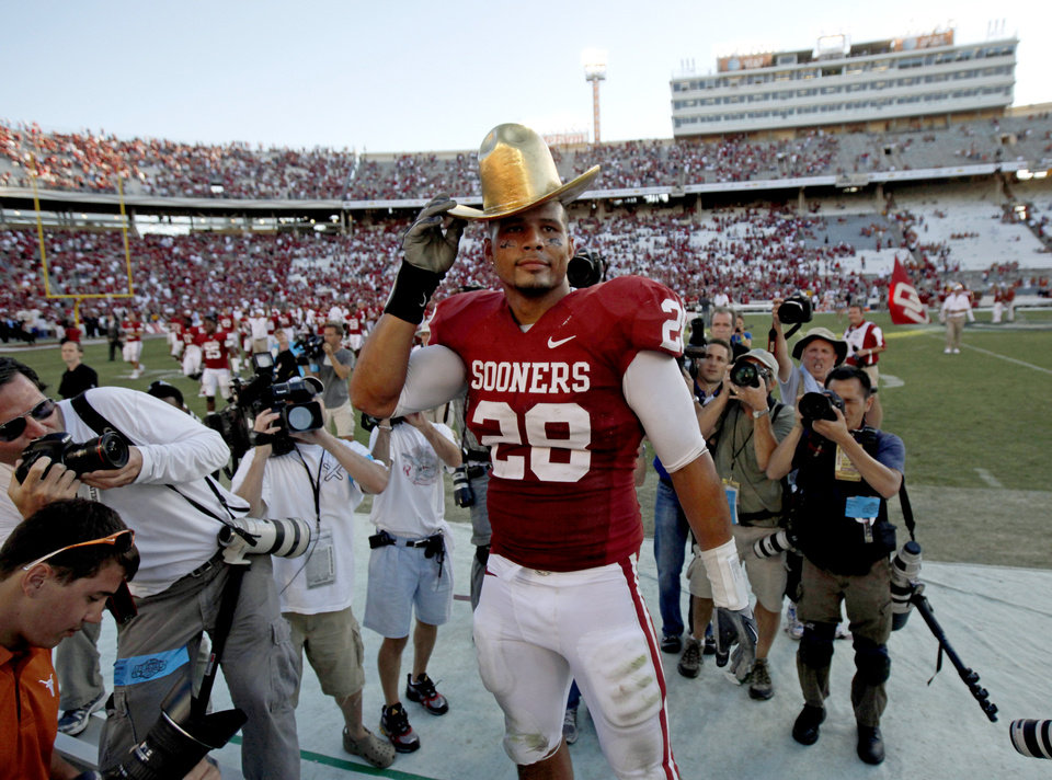 Photo - OU's Travis Lewis wears part of the Golden Hat  trophy after the Red River Rivalry college football game between the University of Oklahoma Sooners (OU) and the University of Texas Longhorns (UT) at the Cotton Bowl on Saturday, Oct. 2, 2010, in Dallas, Texas.  OU defeated Texas 28-20.  Photo by Bryan Terry, The Oklahoman
