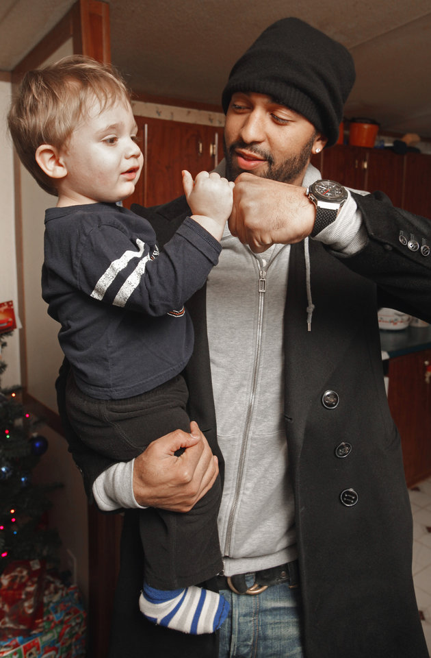 Photo - CHILD / CHILDREN / KIDS / CHRISTMAS / HOLIDAY / GIFTS: Baseball superstar Matt Kemp gets a fist bump from John Burger, 20 months, as he delivers presents to a trailer community on Thursday, Dec. 22, 2011, in Midwest City, Okla.   Photo by Steve Sisney, The Oklahoman