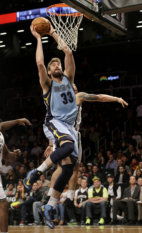 Memphis Grizzlies' Marc Gasol dunks the ball during the first half of the NBA basketball game against the Brooklyn Nets at the Barclays Center Sunday, Feb. 24, 2013 in New York.  (AP Photo/Seth Wenig)