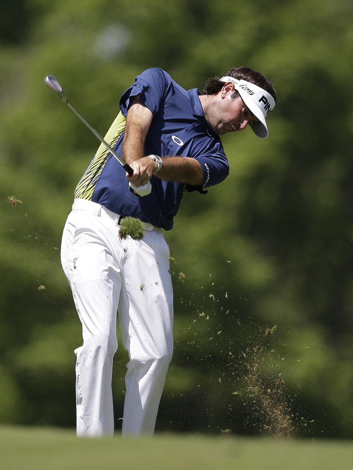 Photo - Bubba Watson hits to the ninth green during the second round of the Memorial golf tournament Friday, May 30, 2014, in Dublin, Ohio. (AP Photo/Darron Cummings)