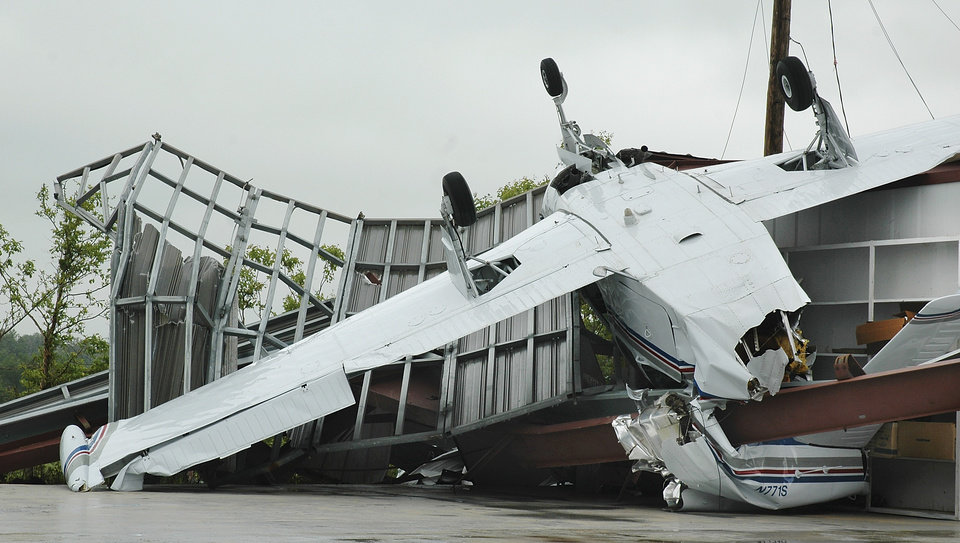 Photo - TORNADO / STORM DAMAGE / PLANE: A small  airplane rests on its top after being blown out of a hangar at the Jimmie Austin Airport  when a tornado touched down on north side of Seminole Monday night.  Damage shown here is Tuesday afternoon, May 11, 2010,   Photo by Ann Kelley, The Oklahoman.