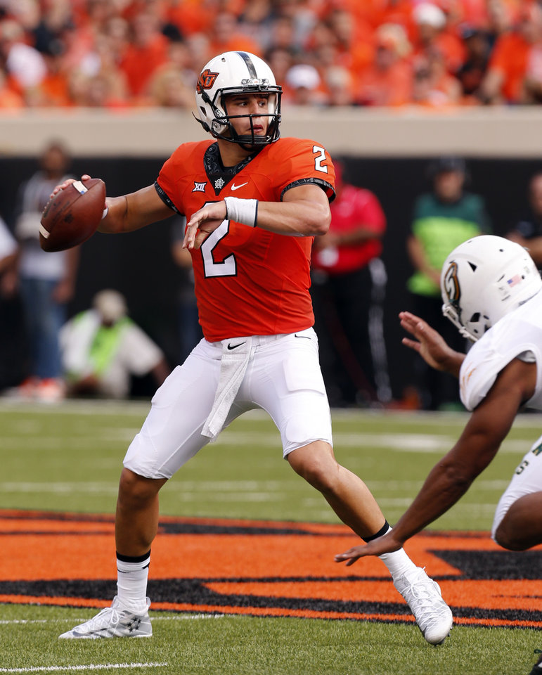 Photo - Oklahoma State's Mason Rudolph (2) throws during the college football game between the Oklahoma State Cowboys (OSU) and the Southeastern Louisiana Lions at Boone Pickens Stadium in Stillwater, Okla., Saturday, Sept. 12, 2015. Photo by Steve Sisney, The Oklahoman