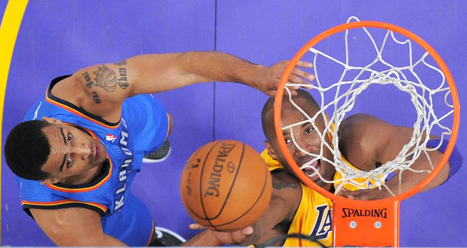 Los Angeles Lakers guard Kobe Bryant, right, puts up a shot as Oklahoma City Thunder guard Thabo Sefolosha defends during the first half of an NBA basketball game, Thursday, March 29, 2012, in Los Angeles. (AP Photo/Mark J. Terrill) ORG XMIT: LAS104