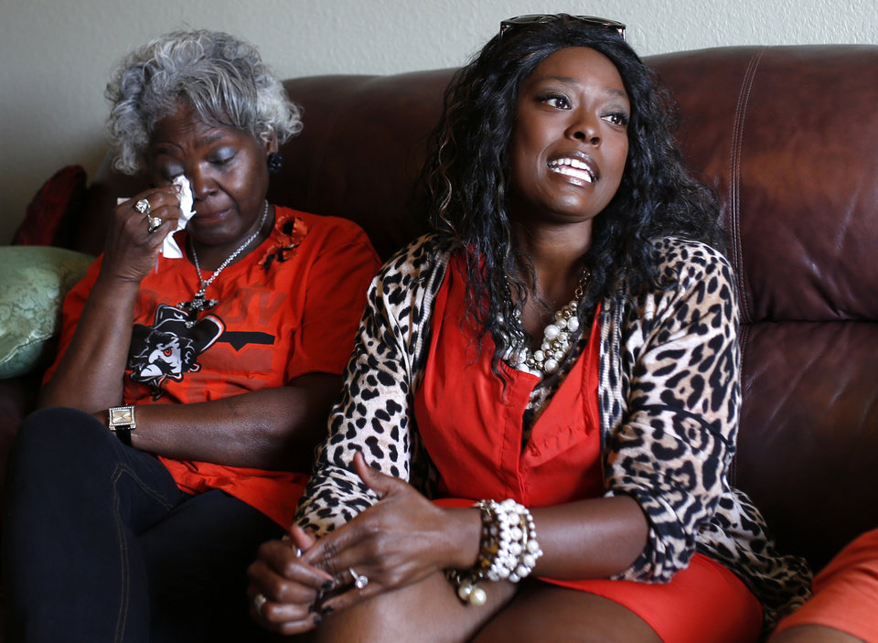 Photo - Mary Annette Turner wipes her eyes as her daughter, Keysha Sanders, talks about visiting her in the ICU. Turner was among the people who were injured when a car ran through a police barricade during last year's Oklahoma State homecoming parade Photo by Sarah Phipps, The Oklahoman