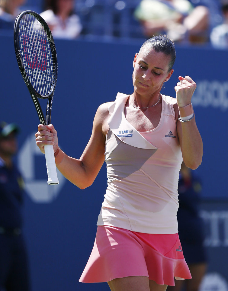 Photo - Flavia Pennetta, of Italy, reacts after defeating Nicole Gibbs, of the United States, during the third round of the 2014 U.S. Open tennis tournament, Saturday, Aug. 30, 2014, in New York. (AP Photo/Matt Rourke)