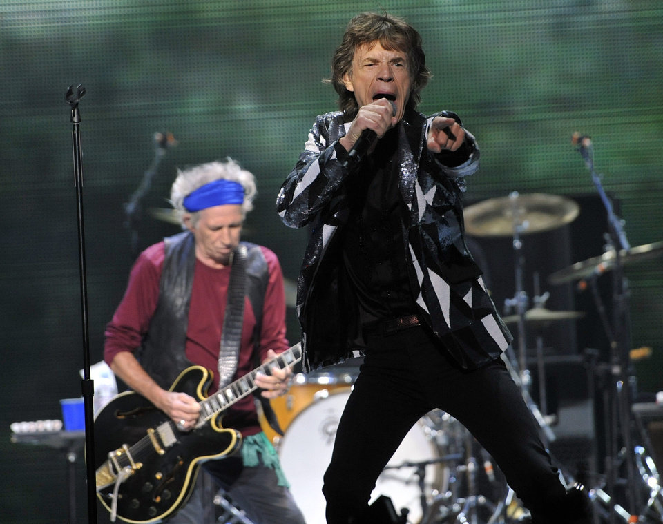 Photo - Mick Jagger, right, and Keith Richards of the Rolling Stones perform at the kick-off of the band's