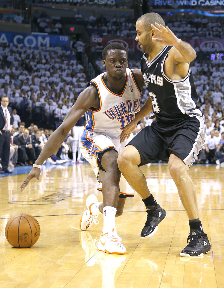 Photo - Oklahoma City's Reggie Jackson (15) tries to get around San Antonio's Tony Parker (9) during Game 6 of the Western Conference Finals in the NBA playoffs between the Oklahoma City Thunder and the San Antonio Spurs at Chesapeake Energy Arena in Oklahoma City, Saturday, May 31, 2014. PHOTO BY BRYAN TERRY, The Oklahoman