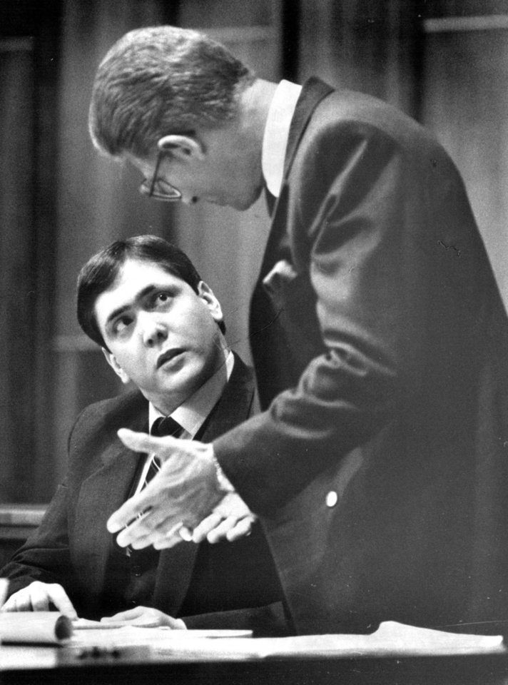 In a March 1988 photo Manuel Pardo, left, confers with his lawyer during his murder trial in March of 1988.  Pardo, 56, is scheduled to be executed Tuesday night Dec. 11, 2012, at Florida State Prison in Starke barring a last-minute stay, fulfilling a request he made to jurors at his 1988 trial.  (AP Photo/The Miami Herald)  MAGS OUT  NO SALES