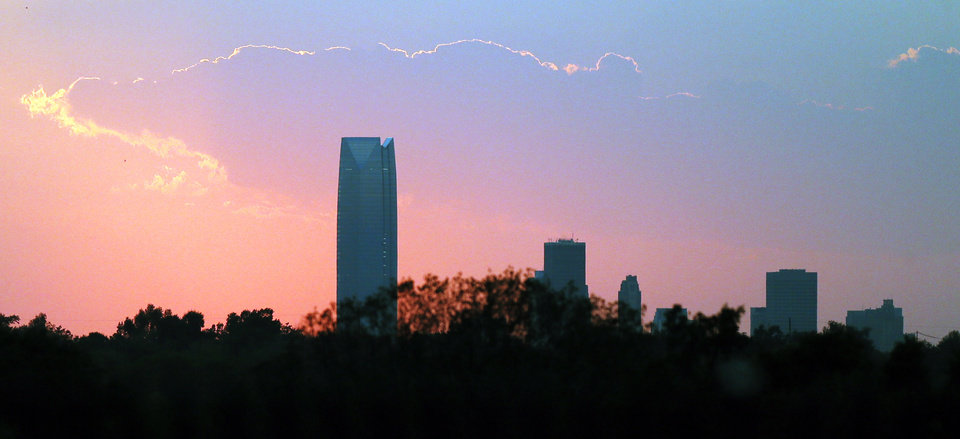 The Devon Tower and the Oklahoma City skyline at sunset viewed from Midwest City, Okla., Friday, Aug. 31, 2012. Photo by Nate Billings, The Oklahoman
