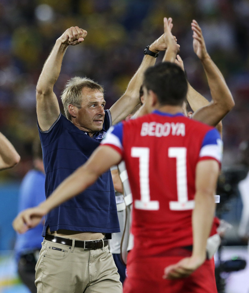 Photo - United States' head coach Juergen Klinsmann celebrates his team's 2-1 victory over Ghana during the group G World Cup soccer match between Ghana and the United States at the Arena das Dunas in Natal, Brazil, Monday, June 16, 2014. (AP Photo/Petr David Josek)