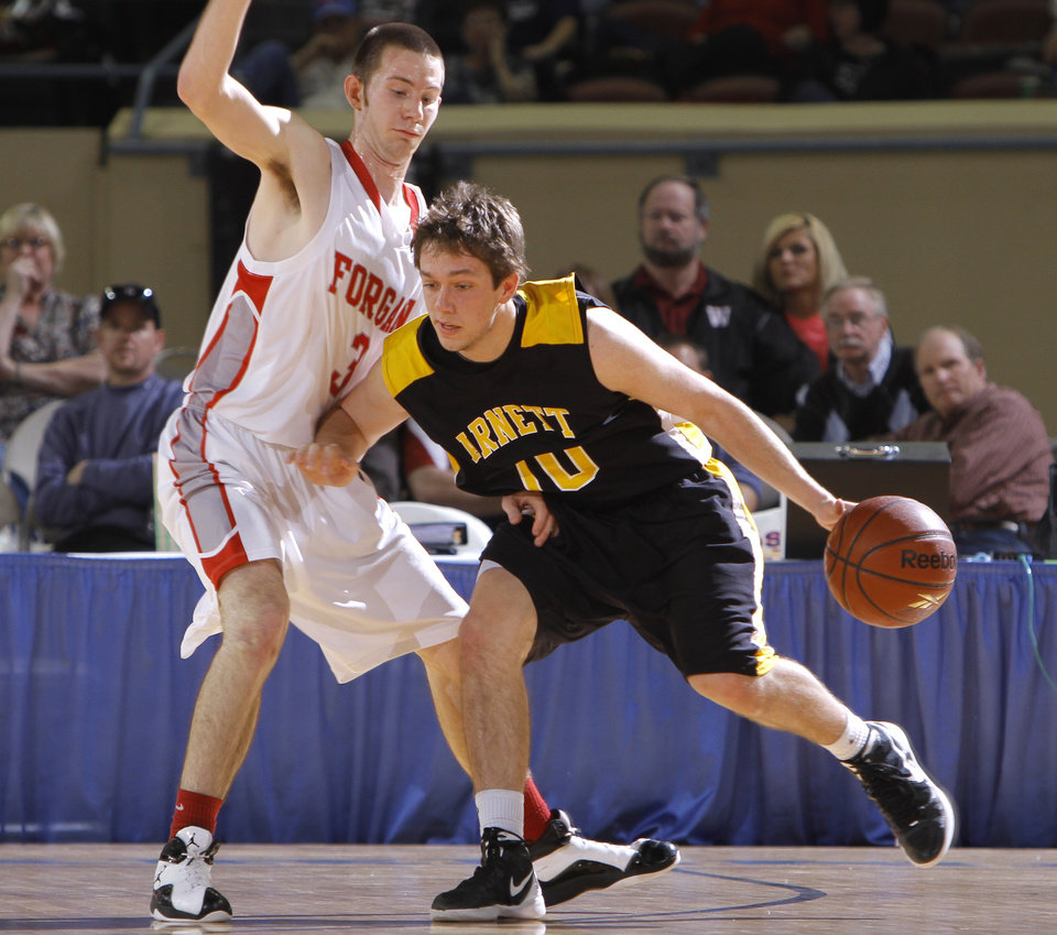 Photo - Arnett's Cody Hunter tries to get by Forgan's Rhett Radcliff during the Class B boys state championship high school basketball game  at the State Fair Arena in Oklahoma City,  Saturday, March 3, 2012. Photo by Sarah Phipps, The Oklahoman