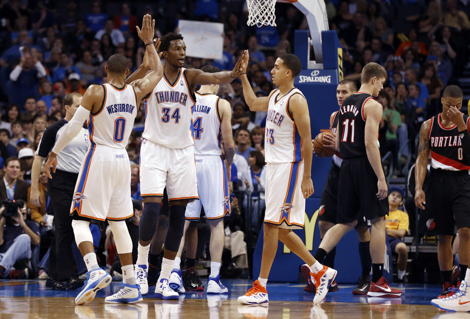 Oklahoma City Thunder\'s Russell Westbrook (0) and Kevin Martin (23) congratulate Hasheem Thabeet (34) on a basket as the Oklahoma City Thunder defeat the Portland Trail Blazers 106-92 in NBA basketball at the Chesapeake Energy Arena in Oklahoma City, on Friday, Nov. 2, 2012. Photo by Steve Sisney, The Oklahoman