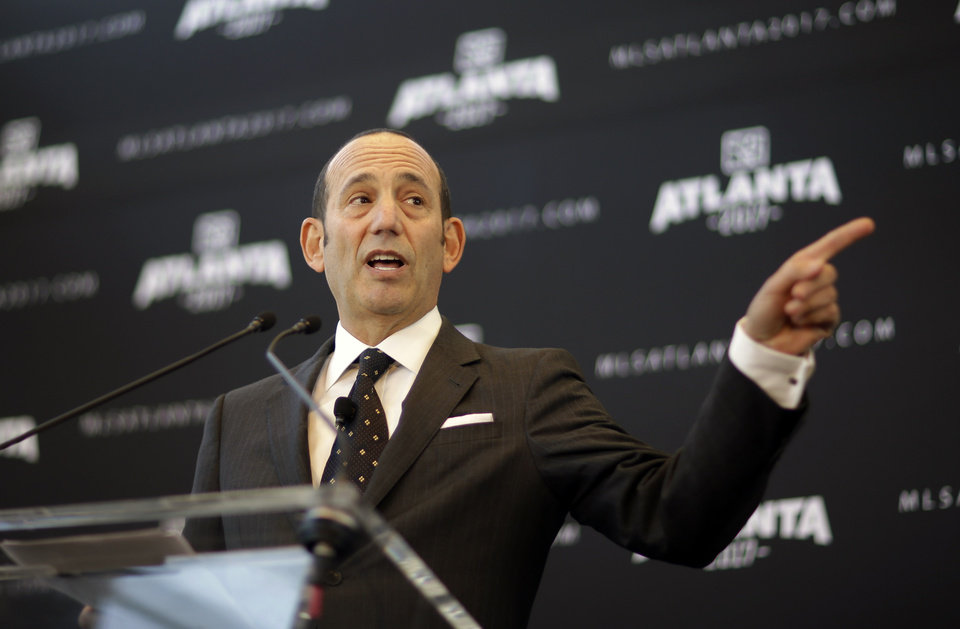 Photo - Major League Soccer Commissioner Don Garber speaks during a news conference announcing the city will be getting an MLS expansion team, Wednesday, April 16, 2014, in Atlanta. MLS announced its newest franchise Wednesday, unveiling a team for Atlanta that will begin play in 2017 at the city's new retractable roof stadium. (AP Photo/David Goldman)