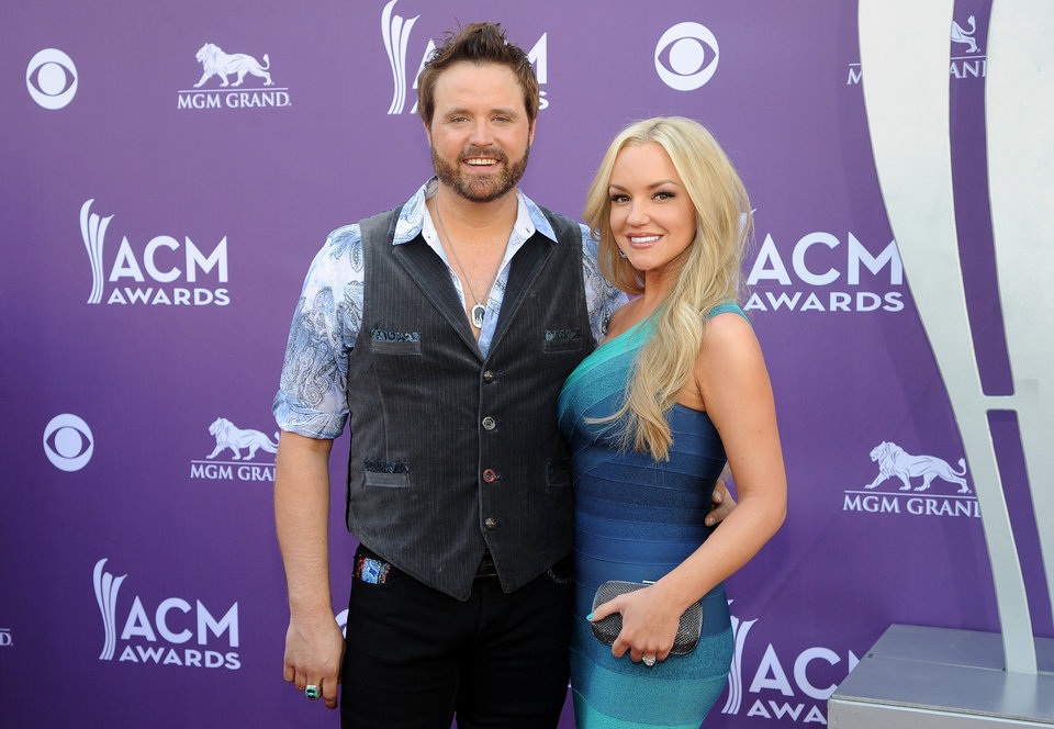 Photo - Singer Randy Houser, left, and Jessa Lee Yantz arrive at the 48th Annual Academy of Country Music Awards at the MGM Grand Garden Arena in Las Vegas on Sunday, April 7, 2013. (Photo by Al Powers/Invision/AP) ORG XMIT: NVPM249