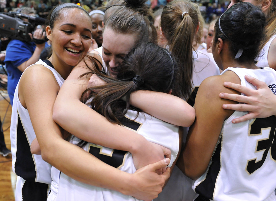 Photo - Army's Brianna Johnson, Jen Hazlett and Kelsey Minato embrace after beating Holy Cross in an NCAA college basketball game in the Patriot League Championship at Christi Arena, Saturday, March 15, 2014, at West Point, N.Y. Army won 68-58. (AP Photo/Karl Rabe)