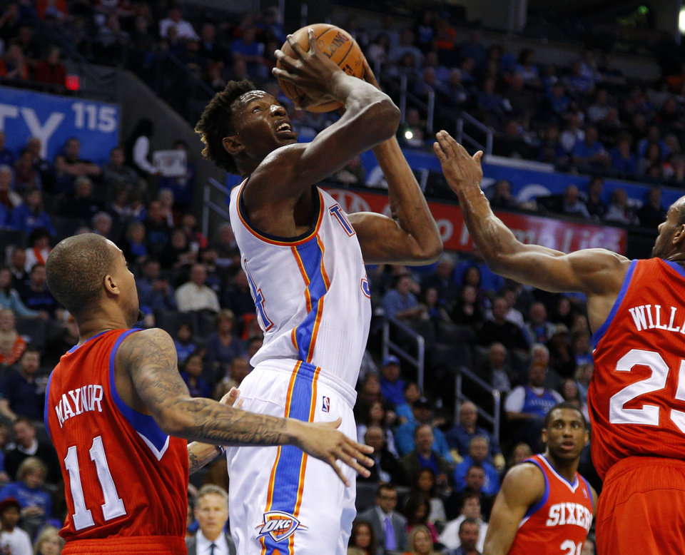 Oklahoma City\'s Hasheem Thabeet (34) goes to the basket beside Philadelphia\'s Eric Maynor (11) and Elliot Williams (25) during an NBA basketball game between the Oklahoma City Thunder and the Philadelphia 76ers at Chesapeake Energy Arena in Oklahoma City, Tuesday, March 4, 2014. Oklahoma City won 125-92. Photo by Bryan Terry, The Oklahoman