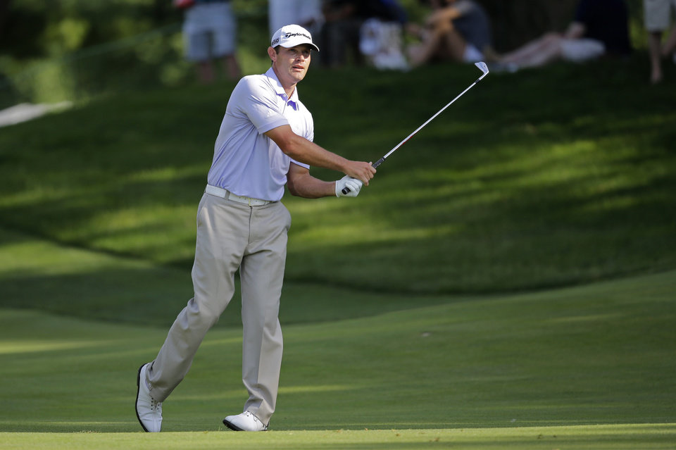 Photo - Shawn Stefani watches his hit from the 17th fairway during the final round of the Quicken Loans National PGA golf tournament, Sunday, June 29, 2014, in Bethesda, Md. Stefani lost the tournament to Justin Rose, of England, in a one-hole playoff round. (AP Photo/Patrick Semansky)