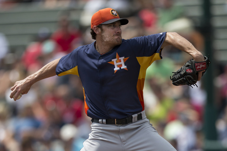 Photo - Houston Astros pitcher Philip Humber delivers a pitch during the first inning of an exhibition spring training baseball game against the Atlanta Braves on Saturday, March 23, 2013, in Kissimmee, Fla.  (AP Photo/Evan Vucci)