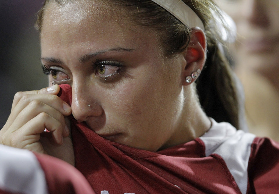 Oklahoma's Destinee Martinez (00) wipes tears from her face after a loss against Alabama in the Women's College World Series softball championship at ASA Hall of Fame Stadium in Oklahoma City, Thursday, June 7, 2012.  Photo by Garett Fisbeck, The Oklahoman