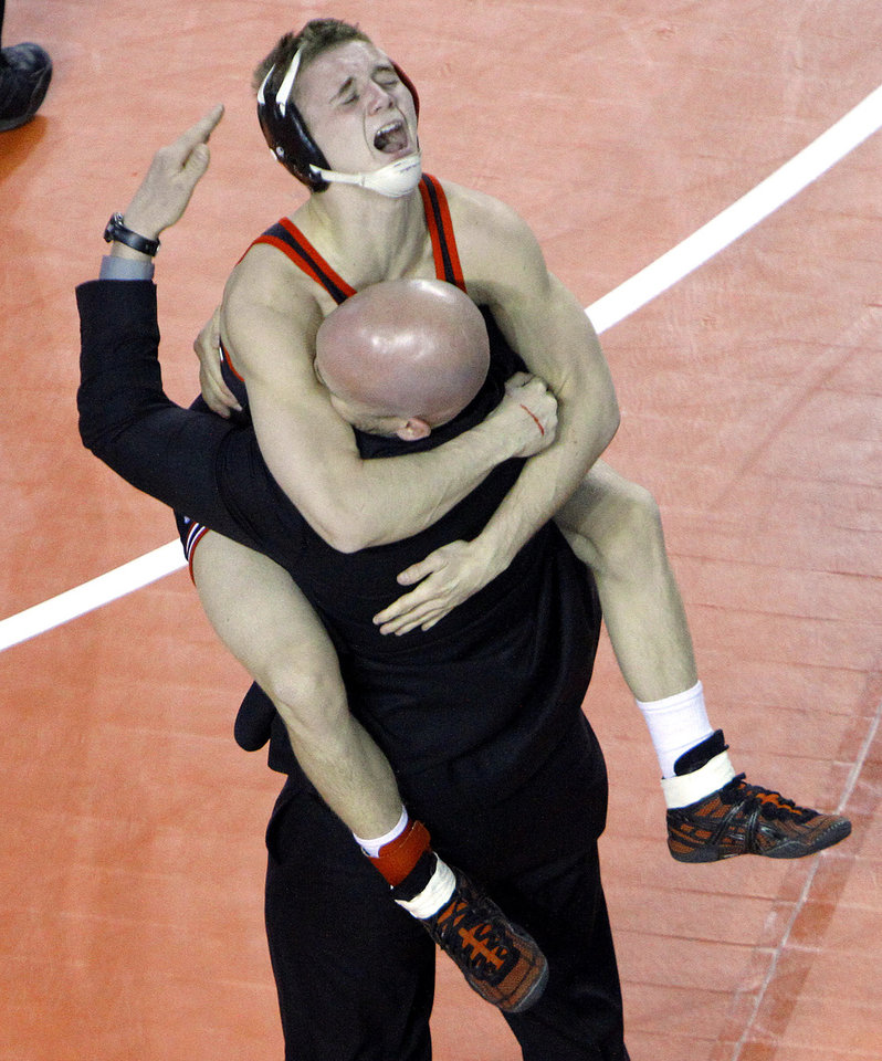 Photo - Claremore's Gunnar Woodburn celebrates with a coach following his victory over Collinsville's Christian Moody  in the the Class 5A 113-pound match during the state wrestling championships at the State Fair Arena in Oklahoma City, Saturday, Feb. 25, 2012. Photo by Sarah Phipps, The Oklahoman