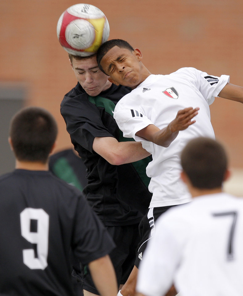 Norman North's Trent Laffoon, left, and Tulsa Union's Ivan Evangelista go for the ball during the boys 6A state championship soccer game in Newcastle, Okla., Saturday, May 12, 2012. Photo by Bryan Terry, The Oklahoman