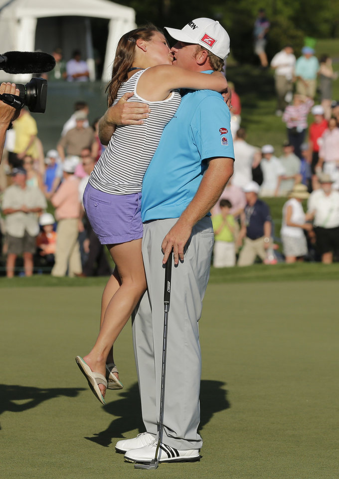 Photo - J.B. Homes, right, kisses his wife Sara, left, after winning during the Wells Fargo Championship golf tournament in Charlotte, N.C., Sunday, May 4, 2014. (AP Photo/Chuck Burton)