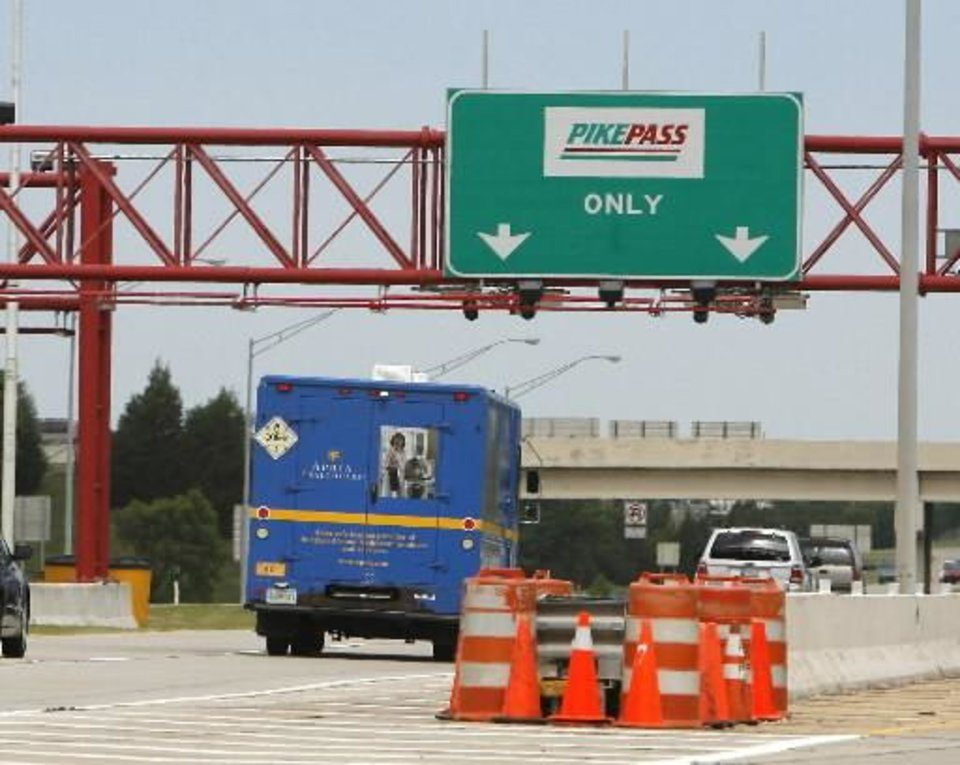 Cars pass through the  PikePass lane on the Kilpatrick Turnpike in Oklahoma City, OK, Tuesday, June 2, 2009. By Paul Hellstern