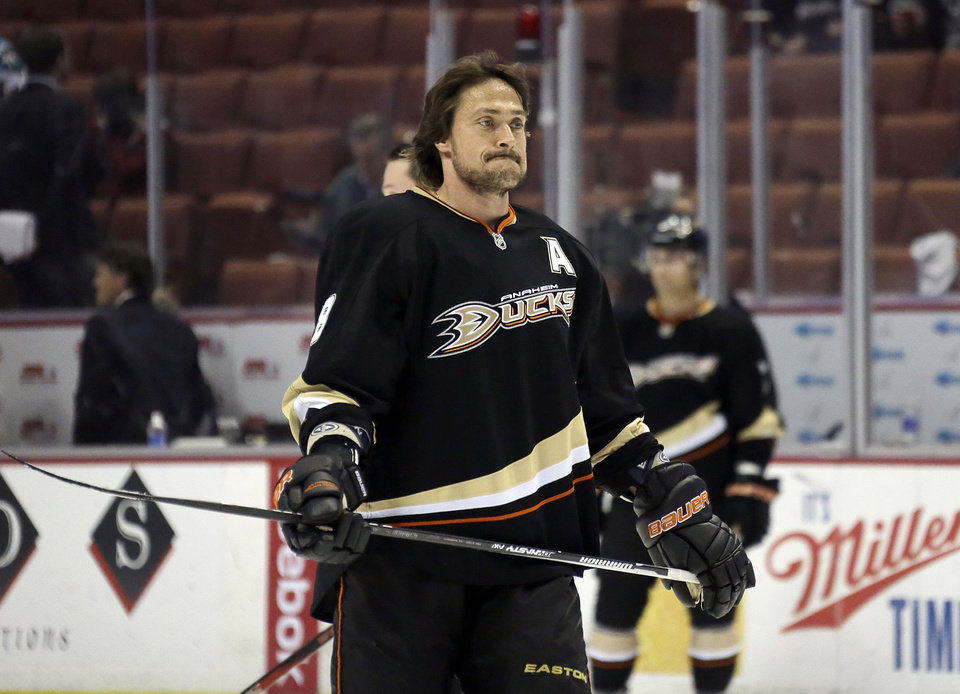 Photo - Anaheim Ducks defenseman Teemu Selanne warms up before the Ducks play the San Jose Sharks in an NHL hockey game in Anaheim, Calif., Monday, March 25, 2013.  With his appearance in the game Monday, Selanne will set a record for the most games played in the NHL by a Finnish-born player.  (AP Photo/Reed Saxon)