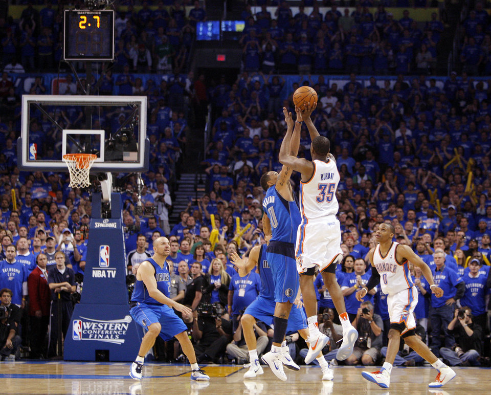 Photo - Oklahoma City's Kevin Durant (35) has his final shot of regulation blocked by Shawn Marion (0) of Dallas in the fourth quarter as Jason Kidd (2) of Dallas and Russell Westbrook (0) of Oklahoma City look on during game 4 of the Western Conference Finals in the NBA basketball playoffs between the Dallas Mavericks and the Oklahoma City Thunder at the Oklahoma City Arena in downtown Oklahoma City, Monday, May 23, 2011. Dallas won in overtime, 112-105. Photo by Nate Billings, The Oklahoman