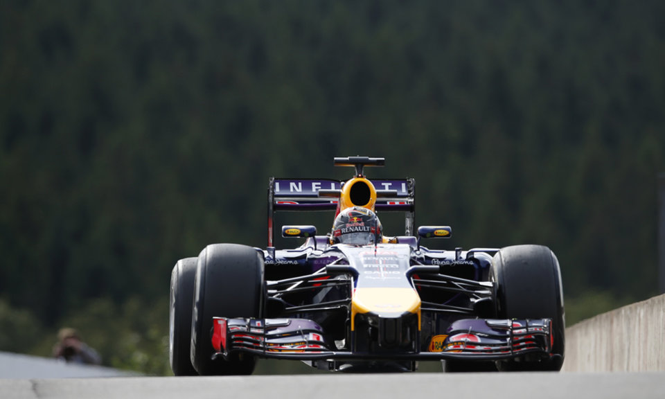 Photo - Red Bull driver Sebastian Vettel of Germany steers his car during the first free practice at the Spa-Francorchamps circuit, Belgium, Friday, Aug. 22, 2014. The Belgium Formula One Grand Prix will be held on Sunday. (AP Photo/Luca Bruno)