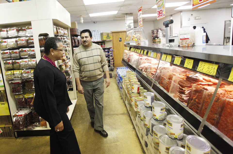 Francisco Ibarra, CEO, shows Small Business Administration Deputy Administrator Marie Johns the meats while touring Supermercados Morelos in Oklahoma City, November 30, 2011. Photo by Doug Hoke, The Oklahoman