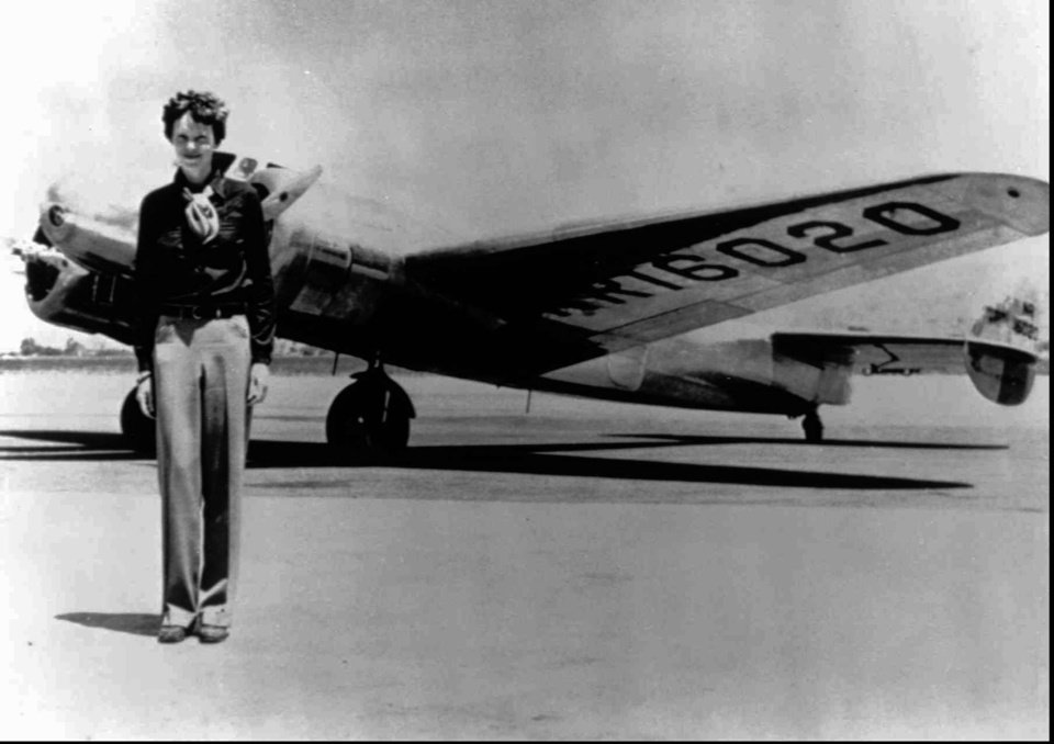Photo - FILE - In this undated file photo, Amelia Earhart stands next to a Lockheed Electra 10E, before her last flight in 1937 from Oakland, Calif., bound for Honolulu on the first leg of her record-setting attempt to circumnavigate the world westward along the Equator. American aviator Earhart's disappearance in 1937 is among aviation's most enduring mysteries. Earhart, the first female pilot to cross the Atlantic Ocean, vanished over the Pacific with Fred Noonan during an attempt to circumnavigate the globe. Seven decades later, people are still transfixed with the mystery. Theories range from her simply running out of fuel and crashing to her staging her own disappearance and secretly returning to the U.S. to live under another identity.   (AP Photo/File)