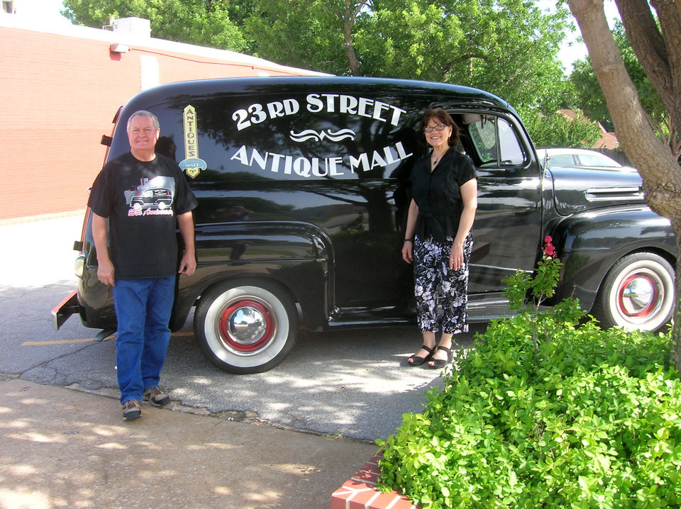 Photo -  Bill and Denny McConnell stand next to their delivery vehicle, a restored 1948 Ford panel truck. Photo by Steve Gust, for The Oklahoman   Steve Gust