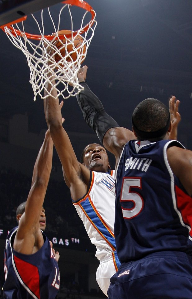 Kevin Durant (35) of Oklahoma City tries to score between Al Horford (15), left, and Josh Smith (5) of Atlanta during the NBA basketball game between the Atlanta Hawks and the Oklahoma City Thunder at the Ford Center in Oklahoma City, Tuesday, February 2, 2010. Photo by Nate Billings, The Oklahoman