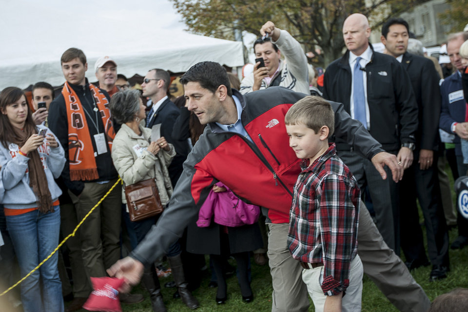 Republican vice presidential candidate, Rep. Paul Ryan, R-Wis., makes a throw in a game, before a football game at Doyt Perry Stadium in Bowling Green, Ohio. (AP Photo/Sentinel-Tribune, Enoch Wu) MANDATORY CREDIT, TOLEDO BLADE OUT