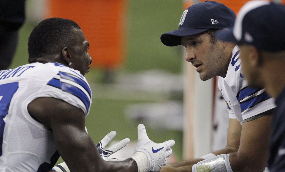 Cowboys receiver Dez Bryant and quarterback Tony Romo (right) talk on the sideline after an argument in the second half of Sunday�s matchup against the Lions. Photo by Brad Loper/Dallas Morning News/MCT