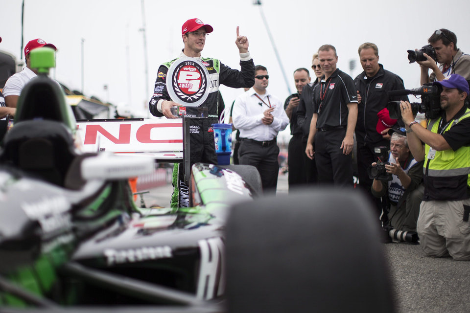 Photo - France's Sebastien Bourdais, centre, celebrates qualifying in pole position for first race of a weekend doubleheader at the IndyCar auto race in Toronto on Saturday, July 19, 2014.  (AP Photo/The Canadian Press, Frank Gunn)