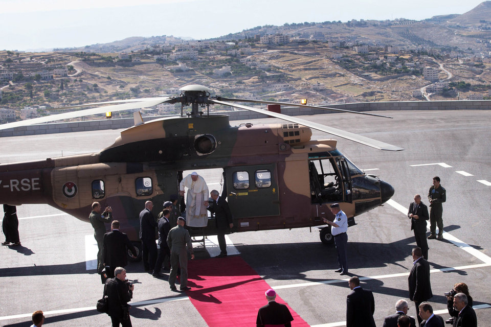 Photo - Pope Francis disembarks a Jordanian military helicopter as he arrives in the West Bank town of Bethlehem on Sunday, May 25, 2014. Francis landed Sunday in the West Bank town of Bethlehem in a symbolic nod to Palestinian aspirations for their own state as he began a busy second day of his Mideast pilgrimage. (AP Photo/Menahem Kahana, Pool)