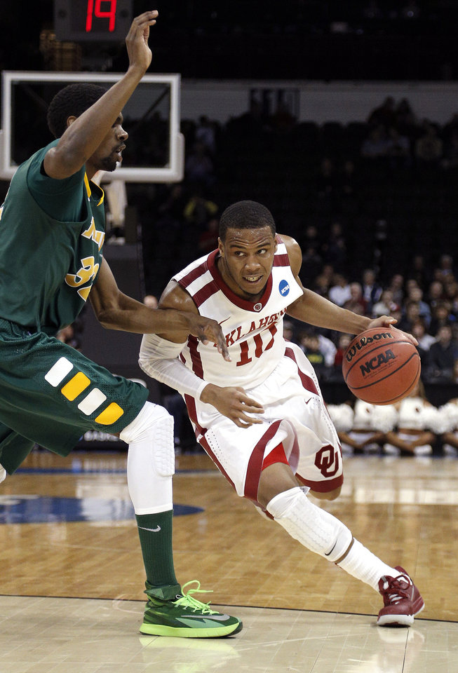Photo - Oklahoma's Jordan Woodard (10) loos to drive past North Dakota State's TrayVonn Wright (32) during the NCAA men's basketball tournament game between the University of Oklahoma and North Dakota State at the Spokane Arena in Spokane, Wash., Thursday, March 20, 2014. Photo by Sarah Phipps, The Oklahoman