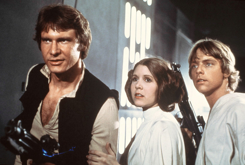 "Photo - From left, Harrison Ford, Carrie Fisher and Mark Hamill portray, respectively, Han Solo, Princess Leia and Luke Skywalker in this photo from the ""Star Wars"" movies. AP PHOTO"
