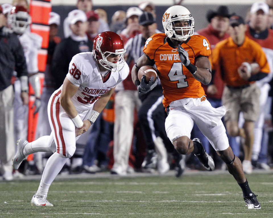 Photo - Oklahoma State's Justin Gilbert (4) returns a kick for a touchdown past Oklahoma's Tress Way (36) during the Bedlam college football game between the University of Oklahoma Sooners (OU) and the Oklahoma State University Cowboys (OSU) at Boone Pickens Stadium in Stillwater, Okla., Saturday, Nov. 27, 2010. Photo by Chris Landsberger, The Oklahoman
