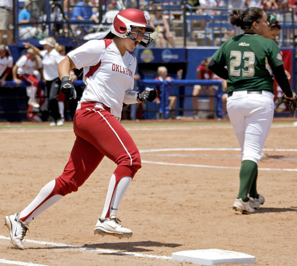 Oklahoma's Lauren Chamberlain rounds first base after hitting a home run against South Florida in the fourth inning of a Women's College World Series game at ASA Hall of Fame Stadium in Oklahoma City, Thursday, May 31, 2012.  Photo by Bryan Terry, The Oklahoman