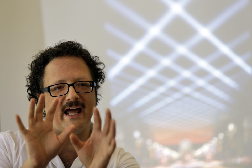 Photo -   In this Aug. 23, 2012 photo, artist Rafael Lozano-Hemmer discusses his new project titled