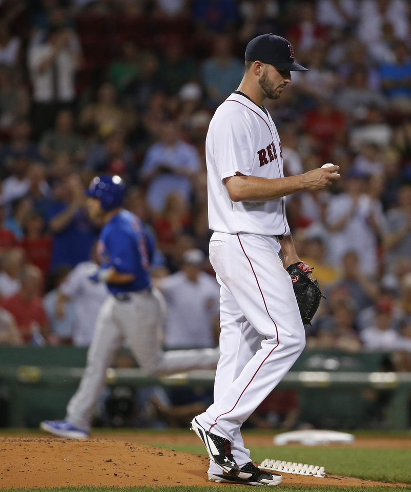 Photo - Boston Red Sox starting pitcher Brandon Workman reacts as Chicago Cubs' Mike Olt rounds third after hitting a two-run homer in the fourth inning of a baseball game at Fenway Park in Boston, Wednesday, July 2, 2014. (AP Photo/Elise Amendola)